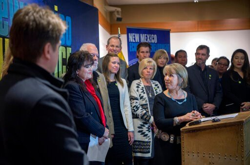 (Eddie Moore/The Albuquerque Journal via AP, File). FILE - In this Feb. 1, 2019, file photo, New Mexico Gov. Michelle Lujan Grisham, center, holds a news conference about film incentives with Sen. Nancy Rodriguez, D-Santa Fe, second from left, and othe...