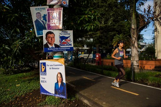 (AP Photo/Oliver de Ros). A woman jogs past political campaign posters at Reforma avenue in Guatemala City, early Saturday, June 15, 2019. The road to Sunday's presidential election in Guatemala has been a chaotic flurry of court rulings and shenanigan...