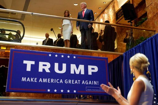 (AP Photo/Richard Drew, File). FILE - In this Sunday, June 16, 2015, file photo, Donald Trump, accompanied by his wife Melania Trump, is applauded by his daughter Ivanka Trump, right as he's introduced before his announcement that he will run for presi...