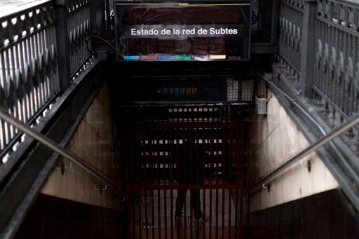(AP Photo/Tomas F. Cuesta). A subway employee stands in the closed entrance of the Buenos Aires's subway during a blackout, in Buenos Aires, Argentina, Sunday, June 16, 2019. Argentina and Uruguay were working frantically to return power on Sunday, aft...
