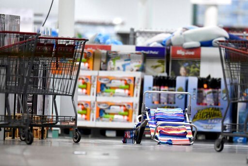 (Will Lester/Inland Valley Daily Bulletin/SCNG via AP). Scattered shopping carts and a flipped over beach chair lays on the ground following a shooting inside a Costco in Corona, Calif.,  Friday, June 14, 2019.  A gunman opened fire inside the store du...