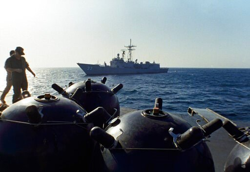 (AP Photo/Mark Duncan, File). FILE - This Sept. 21, 1987 file photo shows mines aboard the Iranian ship Iran Ajr being inspected by a boarding party from the USS Lasalle in the Persian Gulf. Mysterious attacks on oil tankers near the strategic Strait o...