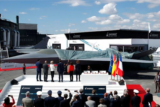 (Benoit Tessier/Pool via AP). French President Emmanuel Macron, Eric Trappier, Chairman and CEO of Dassault Aviation, Dirk Hoke, CEO of Airbus Defense and Space, Spanish Defense Minister Margarita Robles, German Defense Minister Ursula von der Leyen an...