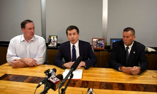 (Santiago Flores/South Bend Tribune via AP). South Bend Mayor Pete Buttigieg, center, speaks during a news conference, Sunday, June 16, 2019, in South Bend, Ind., as South Bend Common Council President Tim Scott, left, and South Bend Police Chief Scott...