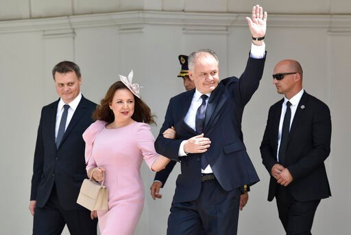 (Dalibor Gluck/CTK via AP). Outgoing Slovak President Andrej Kiska accompanied by his wife Martina waves farewell in front of the Presidential Palace in Bratislava before new Slovak President Zuzana Caputova takes her presidential oath in Bratislava, S...