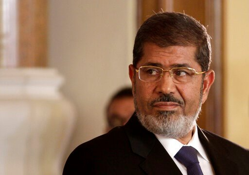 (AP Photo/Maya Alleruzzo, File). FILE - In this July 13, 2012 photo, Egyptian President Mohammed Morsi holds a news conference with Tunisian President Moncef Marzouki, at the Presidential palace in Cairo, Egypt. On Monday, June 17, 2019, Egypt's state ...