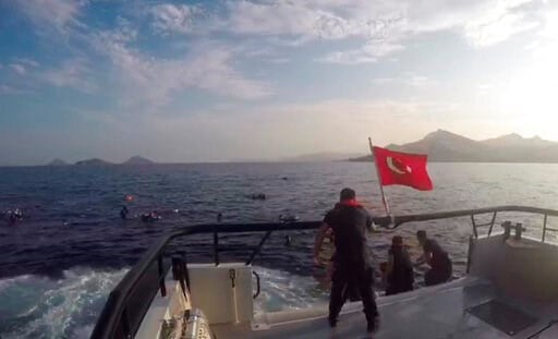 (Turkish Coastguard via AP). In this image taken from video made available by the Turkish Coastguard on Monday June 17, 2019, a coast guard boat approaches migrants in the Aegean Sea. A boat carrying migrants to Greece sank off the Turkish coast on Mon...