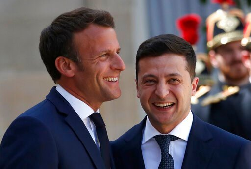 (AP Photo/Christophe Ena). French President Emmanuel Macron, left, greets Ukrainian President Volodymyr Zelenskiy before a meeting at the Elysee Palace, in Paris, Monday, June 17, 2019.