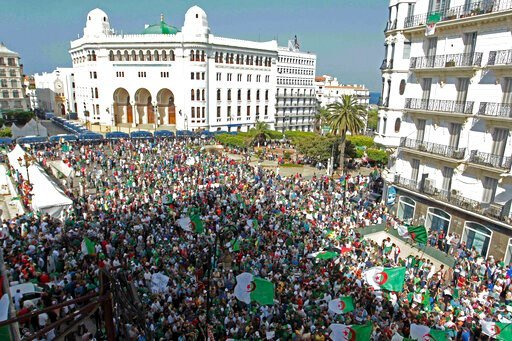 (AP Photo/Fateh Guidoum). Algerian protesters gather during an anti-government demonstration in the centre of the capital Algiers, Algeria, Friday, June 14, 2019.  Algeria is in the midst of an unprecedented anti-corruption crusade, sparked by a people...