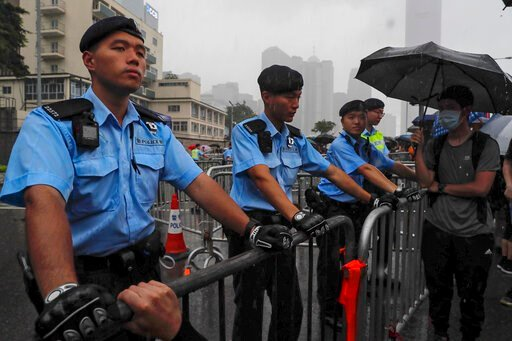 (AP Photo/Kin Cheung). Policemen stand guard in the rain as protesters gather near the Legislative Council continuing protest against the unpopular extradition bill in Hong Kong, Monday, June 17, 2019. A member of Hong Kong's Executive Council says the...