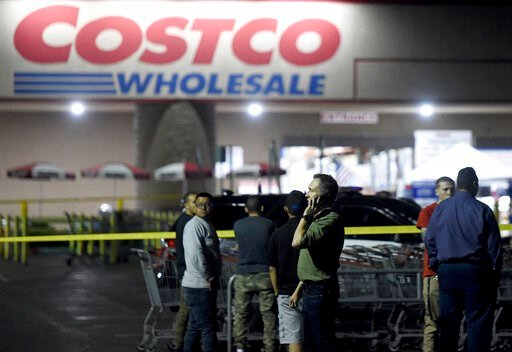 (Will Lester/Inland Valley Daily Bulletin/SCNG via AP). A Costco employee talks on the phone following a shooting within the wholesale outlet in Corona, Calif.,  Friday, June 14, 2019.  A gunman opened fire inside the store during an argument,  killing...