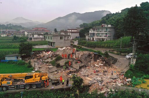 (Zeng Lang/Xinhua via AP). In this photo released by Xinhua News Agency, rescue workers search for trapped people at a collapsed building after an earthquake in Shuanghe Town in Changning County of Yibin City, southwest China's Sichuan Province, Tuesda...
