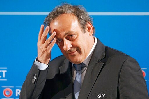 (AP Photo/Lionel Cironneau, File). FILE - In this Feb.22, 2014 file photo, UEFA President Michel Platini arrives at a press conference, one day prior to the UEFA EURO 2016 qualifying draw in Nice, southeastern France. Former UEFA president Michel Plati...