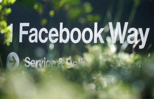 (AP Photo/Jeff Chiu, File). FILE - In this April 25, 2019, file photo an address sign for Facebook Way is shown in Menlo Park, Calif. Facebook unveiled a broad plan Tuesday, June 18, to create a new digital currency.