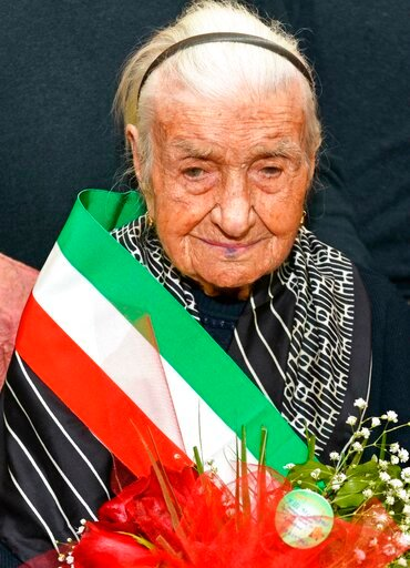 (Franco Cautillo/ANSA via AP). This photo taken on March, 19, 2018 shows Giuseppina Robucci from Poggio Imperiale, near Foggia, Southern Italy. A 116-year-old Italian woman who was the oldest person in Europe and the second-oldest in the world has died...
