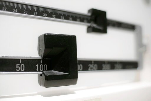 (AP Photo/Patrick Sison, File). FILE - This April 3, 2018, file photo shows a closeup of a beam scale in New York. A study released on Tuesday, June 18, 2019, found U.S. preschoolers on government food aid have grown a little less pudgy, offering fresh...