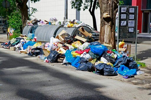 (Foto FENA/Denis Leko). In this photo taken on Thursday, June 13, 2019, piles of trash are seen in the streets of Mostar, Bosnia. Uncollected thrash is piling up on the streets of the southern Bosnian city of Mostar - one of the Balkan nation's main to...
