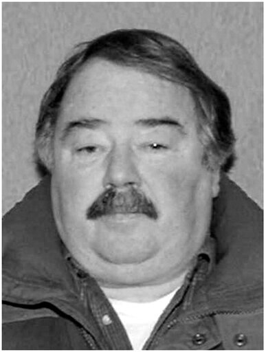 (Courtesy of The Rapid City Police Department via AP). This 2008 drivers license photo released by the Rapid City Police Department shows Eugene Carroll Field. Police say they believe they've solved the murder of a pharmacist who was raped and strangle...