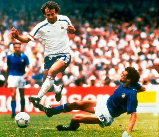 (AP Photo, FILE). FILE - In this file photo dated  June 17, 1986, Michel Platini, left, of France dribbles past Italian forward Alessandro Altobelli in their World Cup eight finals in Mexico City's Azteca Stadium.  France won 2-0 to advance to the quar...