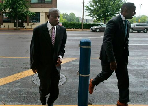 (Robert Cohen/St. Louis Post-Dispatch via AP). Former FBI agent William Don Tisaby, left, is accompanied by attorney Jermaine Wooten as he turns himself in at St. Louis Police headquarters on Monday, June 17, 2019, in St Louis. Tisaby has been charged ...