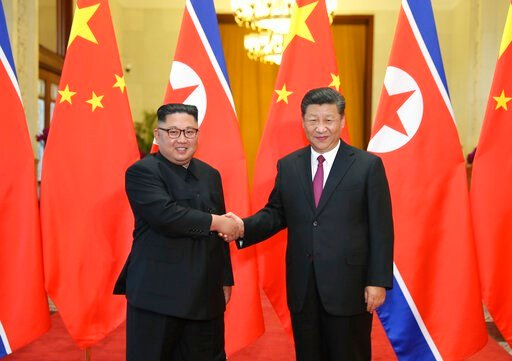 (Ju Peng/Xinhua via AP, File). FILE - In this June 19, 2018, file photo released by China's Xinhua News Agency, Chinese President Xi Jinping, right, poses with North Korean leader Kim Jong Un for a photo during a welcome ceremony at the Great Hall of t...
