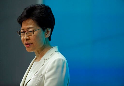 (AP Photo/Vincent Yu). Hong Kong Chief Executive Carrie Lam speaks during a press conference at the Legislative Council in Hong Kong, Tuesday, June 18, 2019. Hong Kong leader apologizes for her handling of unpopular extradition bill, says the city need...