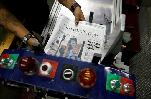 (AP Photo/Steven Senne). In this Thursday, April 11, 2019 photo, copies of The Berkshire Eagle newspaper are placed in a machine before being bundled for distribution, in Pittsfield, Mass. The paper now features a new 12-page lifestyle section for Sund...