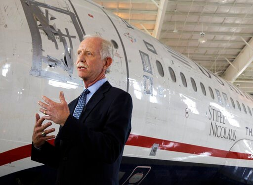 """(AP Photo/Chuck Burton, File). FILE - In this June 11, 2011, file photo, former Capt. Chesley """"Sully"""" Sullenberger talks to the media in front of the US Airways flight 1549 aircraft at the Carolina Aviation Museum in Charlotte, N.C. The president of th..."""