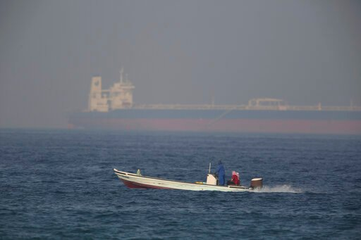(AP Photo/Jon Gambrell). A fishing boat speeds past an oil tanker in the distance in Fujairah, United Arab Emirates, Saturday, June 15, 2019. The Kokuka Courageous, one of two oil tankers targeted in an apparent attack in the Gulf of Oman, was brought ...
