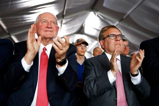 (AP Photo/Patrick Semansky). Agriculture Secretary Sonny Perdue, left, and Environmental Protection Agency Administrator Andrew Wheeler applaud as they listen to President Donald Trump speak at Southwest Iowa Renewable Energy in Council Bluffs, Iowa, T...