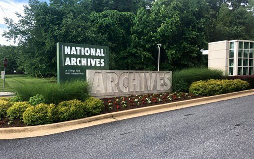 (AP Photo/Michael Kunzelman). In this Tuesday, June 18, 2019 photo a sign for the entrance to the National Archives is seen in College Park, Md. A Virginia National Guard sergeant is accused of stealing World War II-era dog tags from the National Archi...