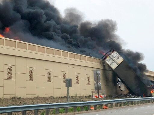 (Katelyn Planka via AP). Smoke billows from a semi after a deadly crash on Interstate 94 in Caledonia, Wis, Wednesday, June 19, 2019. Authorities said the semi crashed and exploded and ignited other vehicles on the interstate in southeastern Wisconsin.