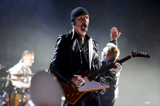 (AP Photo/Thibault Camus, File). FILE - In this Sunday, Dec. 6, 2015, file photo, The Edge of U2 performs on stage during a concert, in Paris. A plan by U2 guitarist The Edge to build a cluster of mansions on a ridgeline above Malibu appears dead, afte...