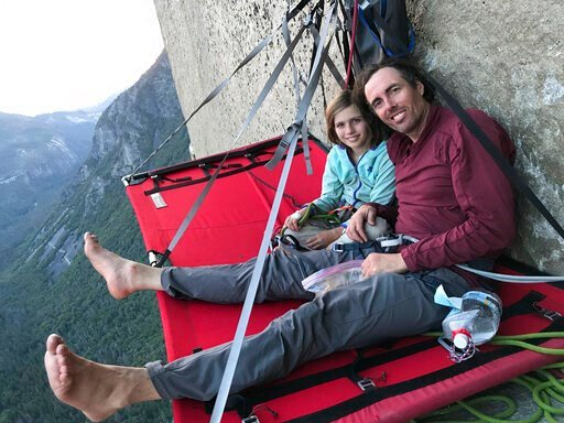 (Michael Schneiter via AP). In this June 11, 2019, photo, is Michael Schneiter posing with his daughter, Selah Schneiter, during her climb up El Capitan in Yosemite National Park, Calif. A 10-year-old Colorado girl has scaled Yosemite National Park's E...