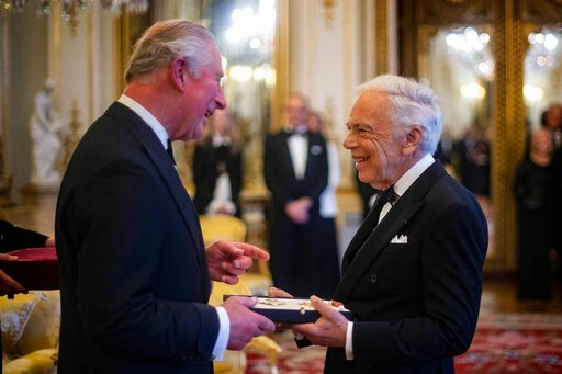 (Victoria Jones/PA via AP). The Prince of Wales presents designer Ralph Lauren with his honorary KBE (Knight Commander of the Order of the British Empire) for Services to Fashion in a private ceremony at Buckingham Palace Wednesday June 19, 2019.