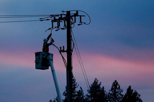 (AP Photo/Rich Pedroncelli, File). FILE - In this Nov. 26, 2018, file photo, a Pacific Gas & Electric lineman works to repair a power line in fire-ravaged Paradise, Calif. Pacific Gas & Electric said Wednesday, June 19, 2019, that it discovered...