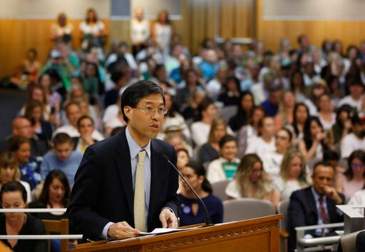 (AP Photo/Rich Pedroncelli, File ). FILE -- In this April 24, 2019 file photo State Sen. Dr. Richard Pan, D-Sacramento, urges lawmakers to approve his proposal to give state public health officials instead of local doctors the power to decide which chi...
