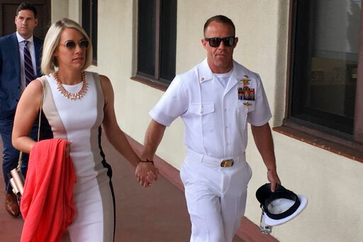(AP Photo/Julie Watson). Navy Special Operations Chief Edward Gallagher, right, walks with his wife, Andrea Gallagher as they arrive to military court on Naval Base San Diego, Tuesday, June 18, 2019, in San Diego. Jury selection continued Tuesday morni...