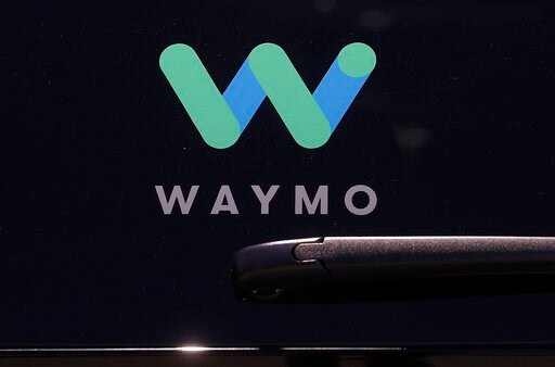 (AP Photo/Jeff Chiu, File). FILE - This Tuesday, May 8, 2018, file photo shows a Waymo logo displayed on the window of a car at the Google I/O conference in Mountain View, Calif. Self-driving car pioneer Waymo is teaming up with automakers Renault and ...