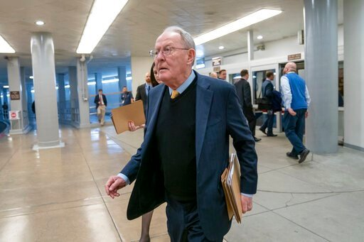 (AP Photo/J. Scott Applewhite, File). FILE - In this Feb. 12, 2019, file photo, Sen. Lamar Alexander, R-Tenn., walks to the Senate at the Capitol in Washington. A new study says about once in every six times someone is taken to an emergency room or che...