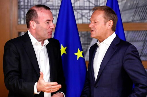 (Olivier Hoslet, Pool Photo via AP). European People's Party member and Candidate for the next president of the European Commission, Germany's Manfred Weber, left, speaks with European Council President Donald Tusk ahead to a meeting on EU top jobs at ...