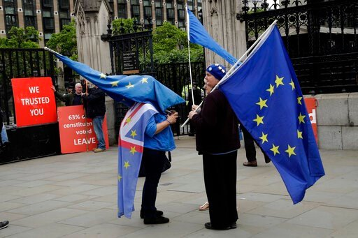(AP Photo/Matt Dunham). Anti-Brexit remain supporters stand with European flags and pro-Brexit leave supporters hold red placards as they all protest outside the Houses of Parliament in London, Wednesday, June 19, 2019. Britain's Conservative Party are...