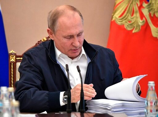 (Alexei Nikolsky, Sputnik, Kremlin Pool Photo via AP). Russian President Vladimir Putin reads documents as he chairs a meeting ahead of his annual question and answer session which is to take place on June 20, in Moscow, Russia, Wednesday, June 19, 2019.