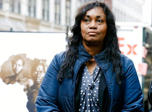 """(AP Photo/Frank Franklin II, File). FILE - In this March 20, 2019 file photo Tamara Lanier attends a news conference near the Harvard Club, in New York. Lanier, of Norwich, Conn., is suing the Harvard University for """"wrongful seizure, possession and ex..."""