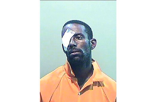 """(Detroit Police Department via AP). This undated booking photo released by Detroit Police Department shows Deangelo Kenneth Martin, 34. Prosecutors have charged Martin, the Detroit man who police call a """"person of interest"""" in the deaths of three women..."""