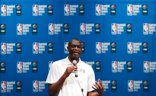 (AP Photo/Themba Hadebe). FILE - In this Aug. 1, 2018, file photo, Dikembe Mutombo speaks during the opening ceremony of Basketball without Borders Africa in Johannesburg, South Africa. U.S. health officials are turning to a basketball hall of famer fo...