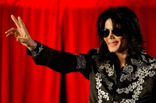 (AP Photo/Joel Ryan, File). FILE - This March 5, 2009 file photo shows Michael Jackson as he announces ten live concerts at the London O2 Arena in south London. Tuesday, June 25, 2019, marks the tenth anniversary of Jackson's death.