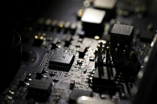 (AP Photo/Jenny Kane, File). FILE - This Feb 23, 2019, file photo shows the inside of a computer in Jersey City, N.J. Facebook unveiled a broad plan Tuesday, June 18, to create a new digital currency.