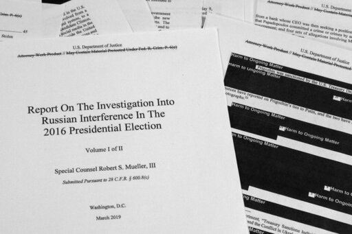 (AP Photo/Jon Elswick, File). FILE - In this April 18, 2019, file photo, special counsel Robert Mueller's redacted report on Russian interference in the 2016 presidential election is photographed in Washington. The Mueller Report is no longer just a bo...