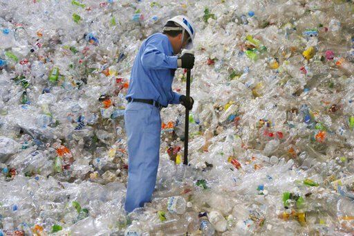 (AP Photo/Koji Sasahara). In this June 18, 2019, photo, a plastic recycling company worker sorts out plastic bottles collected for processing at Tokyo Petbottle Recycle Co., Ltd, in Tokyo. Japan has a plastic problem. Single bananas here are sometimes ...